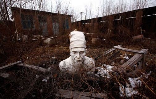 Abandoned bust of Confucious in the abandonded village of Dangcheng, southwest of Beijing